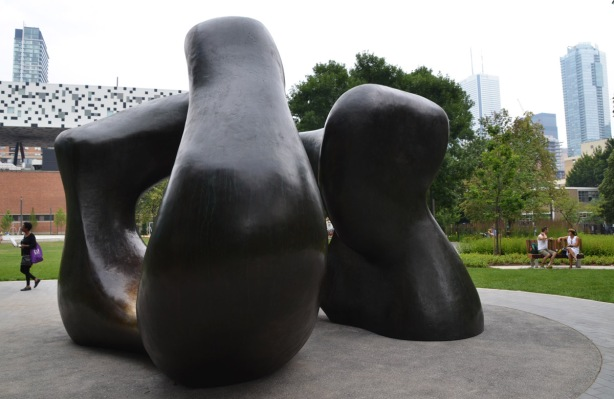 the Henry Moore sculpture, Large Two Forms, in Grange Park behind the Art Gallery of Ontario , a couple on a bench beside it