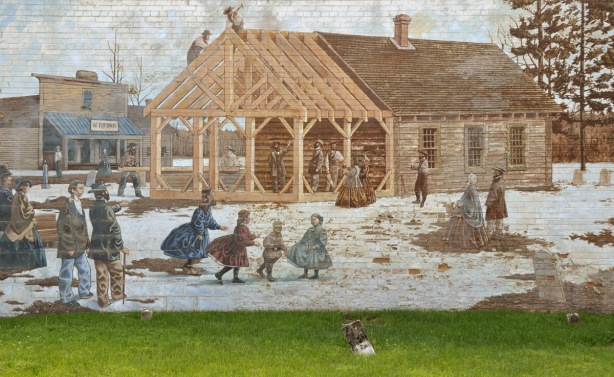 men up on the roof of a new addition on a building, constructing roof joists, winter scene, old fashioned
