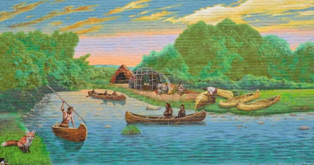 part of a larger mural showing the story of Port Union - First Nations people in canoes on the river with teepees and people on the shore
