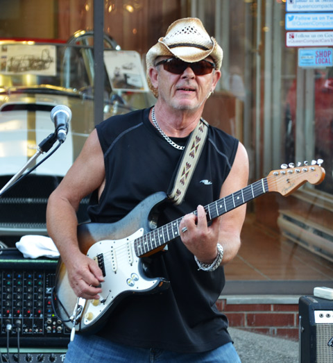 guitarist, neil chapman, playing outside.