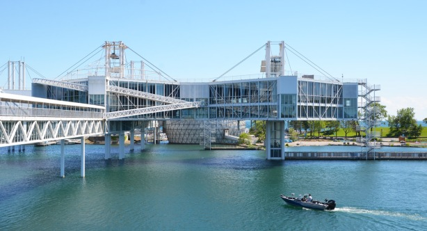 buildings with lots of glass, on stilts, built over the water at Ontario Place