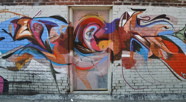 mural on a wall in Toronto alley, part of #womenpaintTO