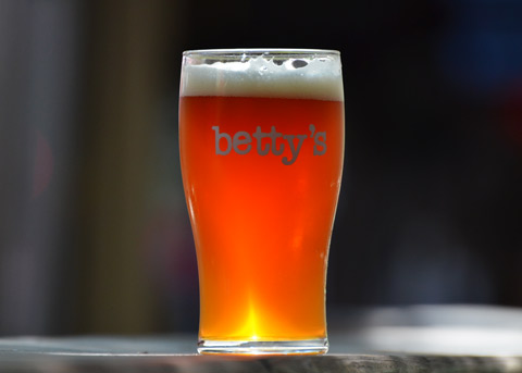 a Bettys glass, full of beer, in the sun