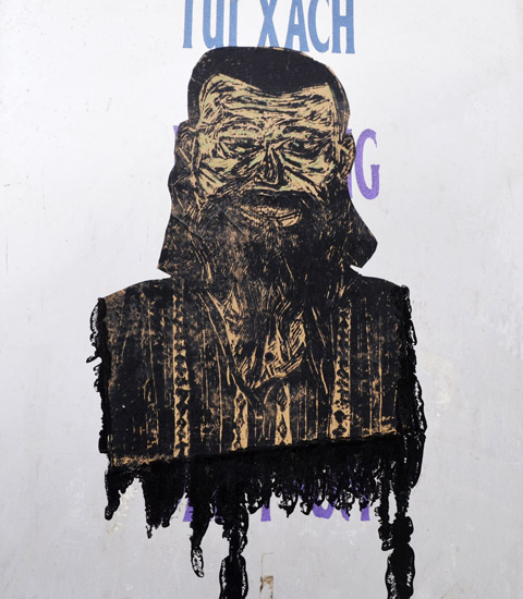 street art paste up of a man's head and shoulders, ugly, long beard, high collar, striped shirt