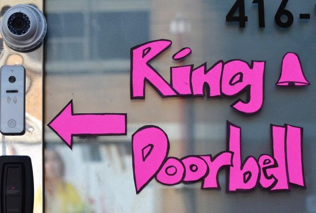 ring doorbell sign in large pink letter