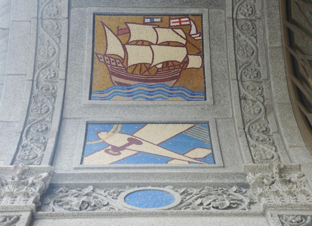 two of the panels designed by J.E. H. MacDonald on the Concourse building, a ship with sails, and an airplane