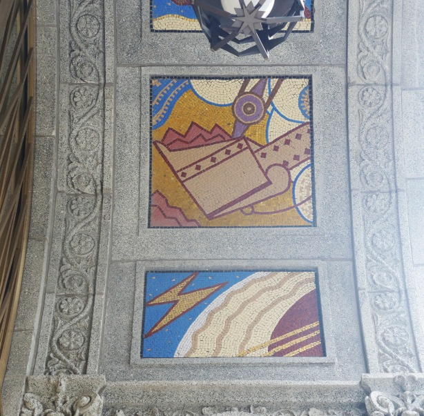 two of the panels designed by J.E. H. MacDonald on the Concourse building, a steam shovel in action, and a panel with a lightning bolt