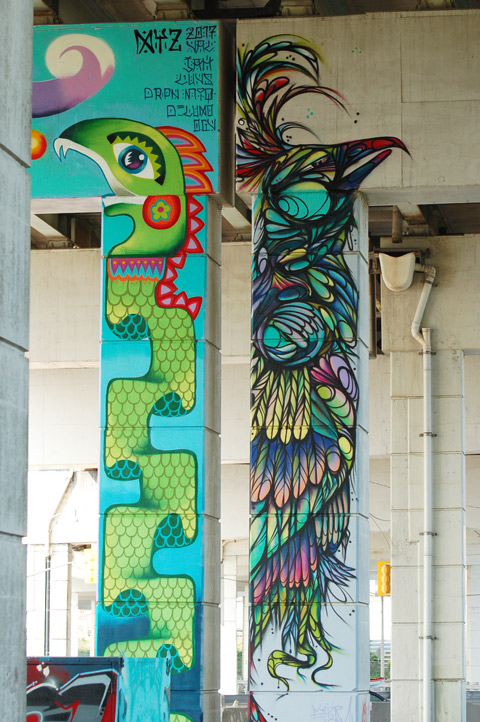 part of a colourful mural on concrete pillars under the Gardiner Expressway