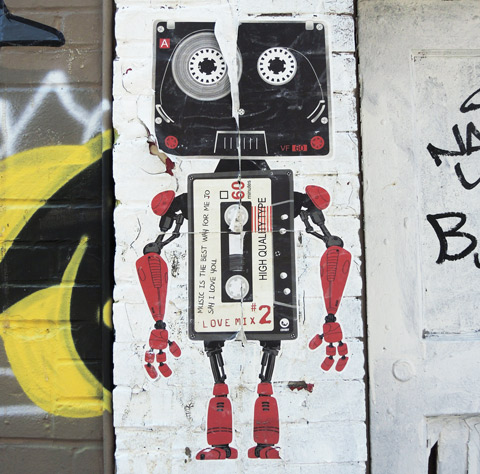 graffiti man drawn with two cassette tapes, one as head and the other as body, love mix #2,