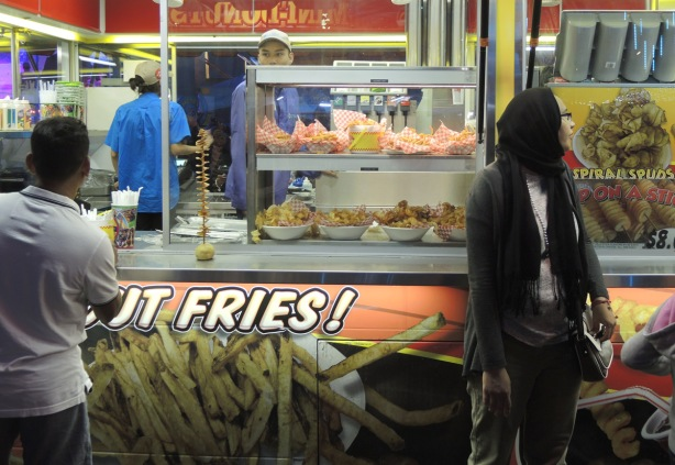 people around a food vendor at the CNE, fries,