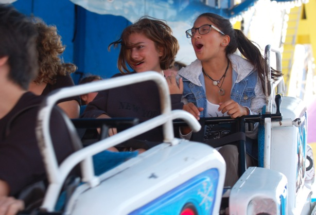 two young women on a ride at the ex