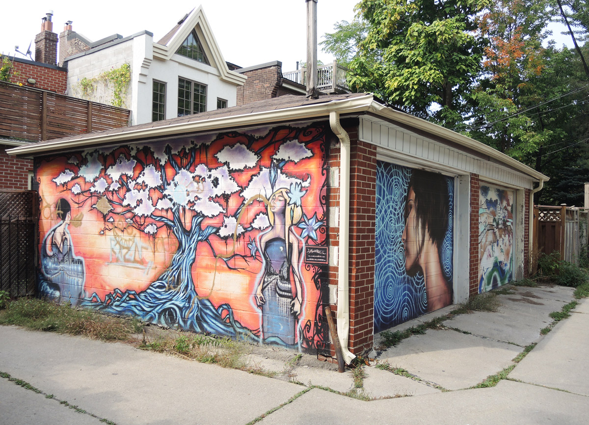 A Two Car Garage In An Alley, Murals On Both Garage Doors As Well As