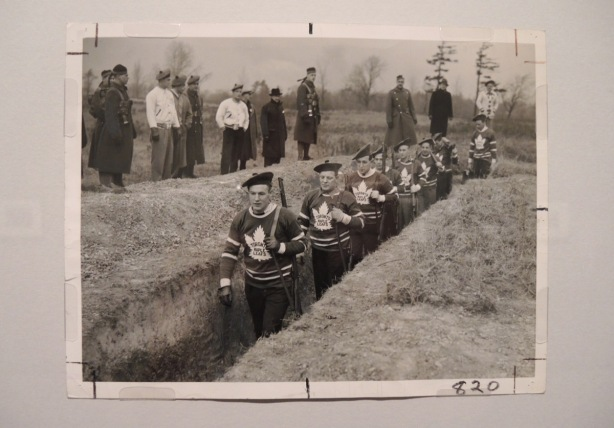 vintage photo of men in Maple Leafs hockey sweaters walking through war trenches