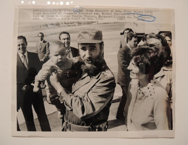 vintage black and white photo of Margaret Trudeau and Fidel Castro. Castro is holding one of the Trudeau sons.