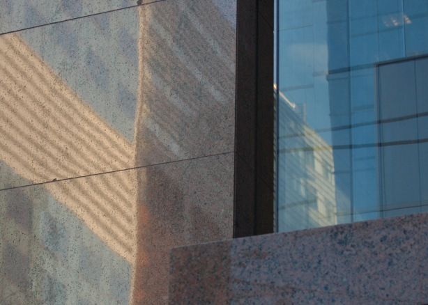 reflections in a stone and glass building