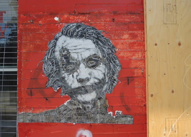 Heath Ledger as the Joker, paper paste up of the head and shoulders