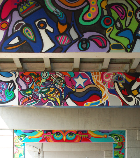 part of a colourful mural on concrete pillars under the Gardiner Expressway - 3 horizontal paintings on the bents,