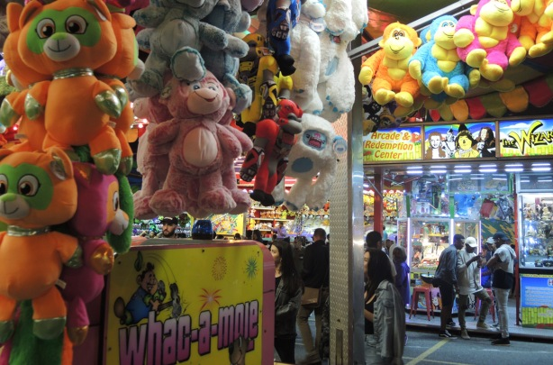 Whac-a-mole game prizes on the CNE midway, people