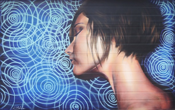 women with sohort dark hair from the neck up, side view, eyes closed, mural on a garage door by Aaron Li-Hill