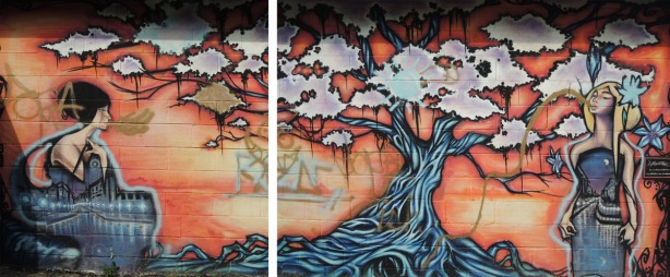 a mural in two pictures of two women and a large tree by Aaron Li-Hill on the side of a garage in an alley