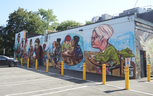 mural by elicser of people - whole mural, completed, on Barbara Barrett Lane, musicians and the people listening to them as they sit at tables