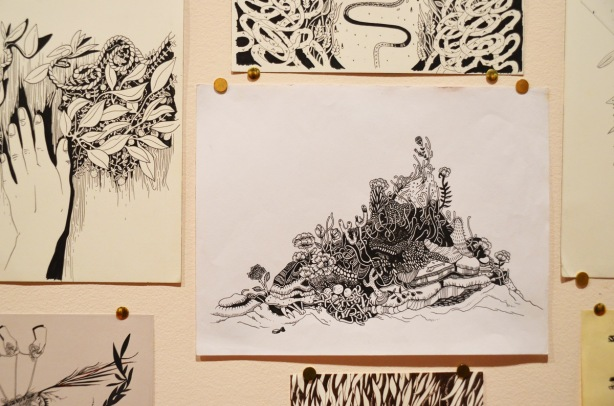 pen and ink, and paint, drawings by sab meynert on a gallery wall, thumb tacked to the wall, black and white, intricate
