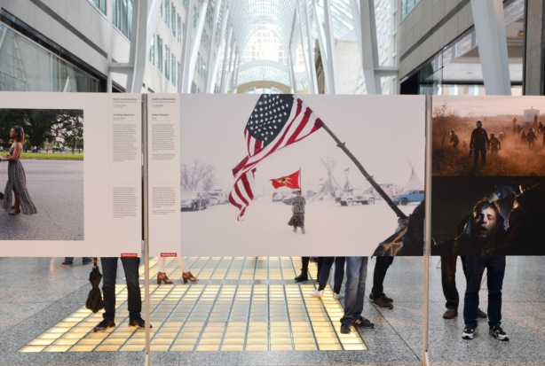 photos at an exhibition at Brookfield Place (Alan Lambert Galleria), of portest of Dakota Access Pipeline, by Canadian photographer Amber Bracken
