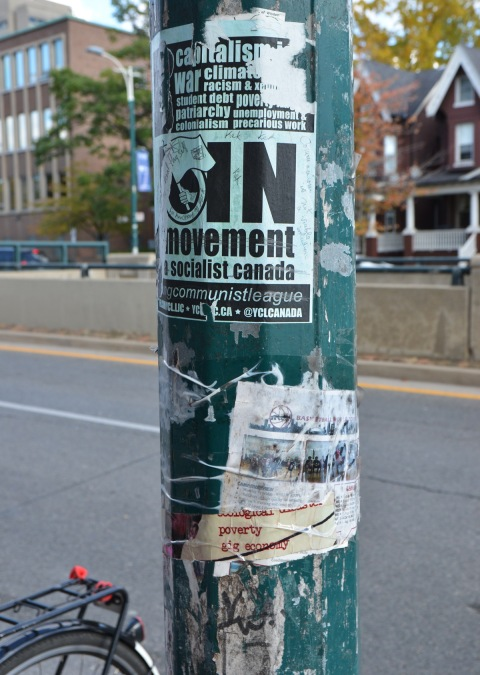 old posters on a a green utility pole, Join the socialist movement in Canada, gig economy,