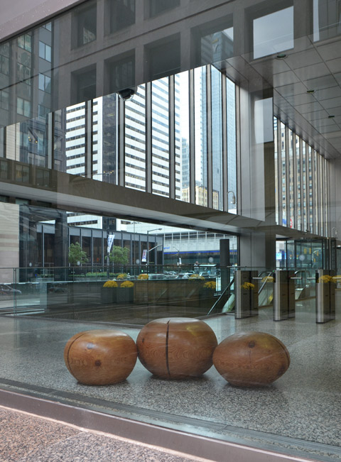 three rock-like sculptures inside a window