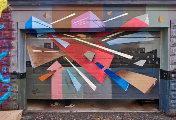 geometric abstract mural in browns and red and blues, by andre