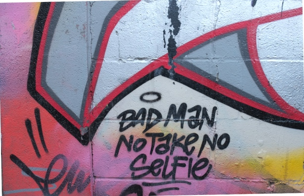graffiti words on a wall in Graffiti Alley, bad man no take no selfie