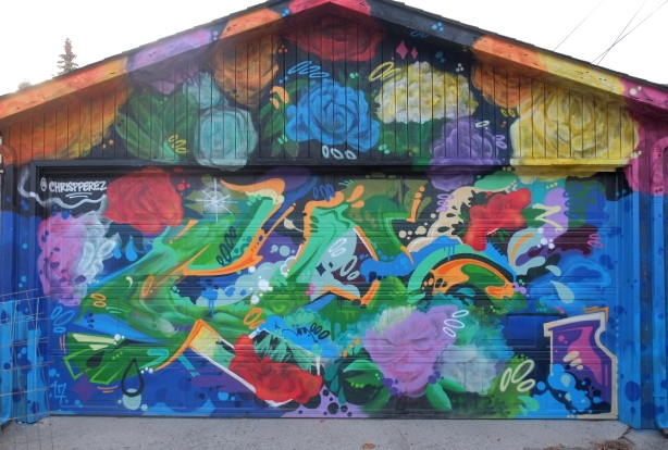 a garage covered with colour splotches