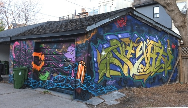 sides and front of garage with street art on them