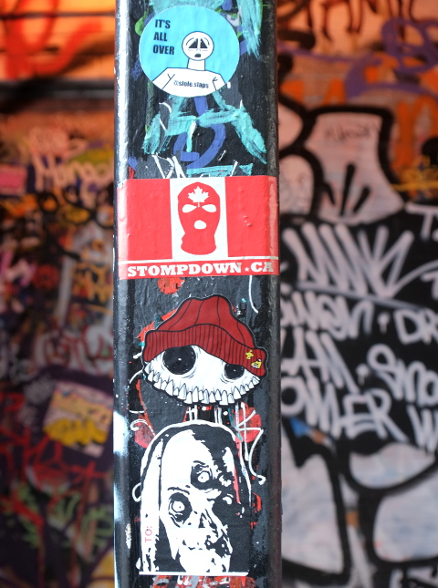 stickers graffiti in an alley