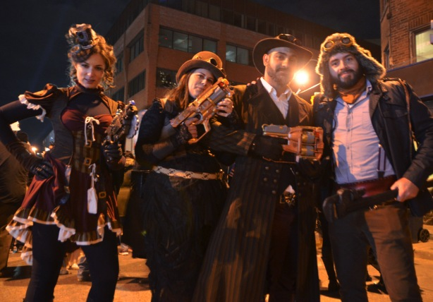 a group dressed up for Halloween, night time, street party, 2 women, 2 men, toy guns, gangsters and burlesque.