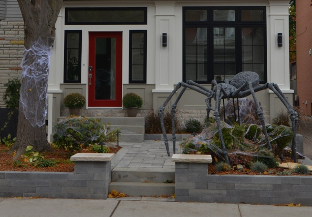 a giant spider halloween decoration in front of a house