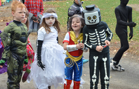 kids in Halloween costumes laughing together