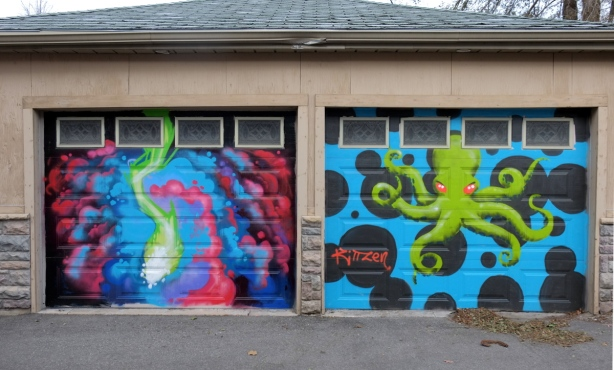 two garage doors with murals of marine life, a squid on the left and an octopus on the right.