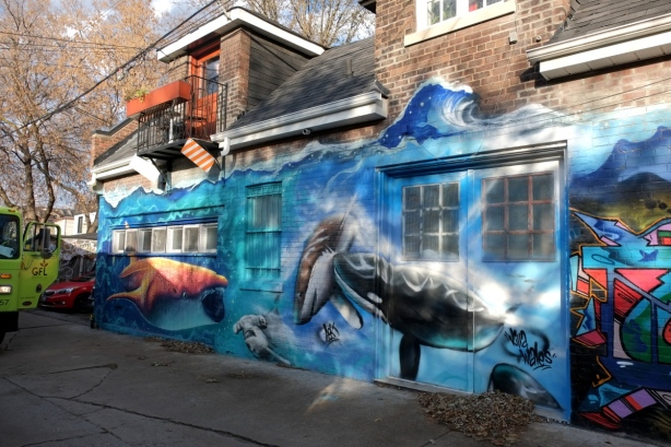 large mural with marine life theme, whale, blue background for water,
