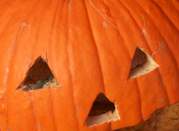 part of a jack o'lantern carved pumpkin for halloween, triangle eyes and nose