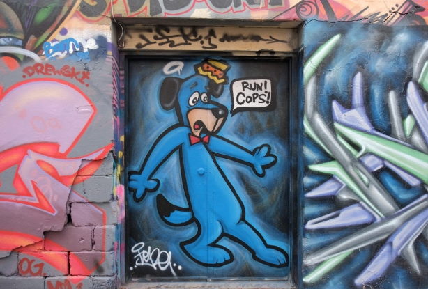 mural in Graffiti Alley - cartoon dog in blue on door, with words run cops!