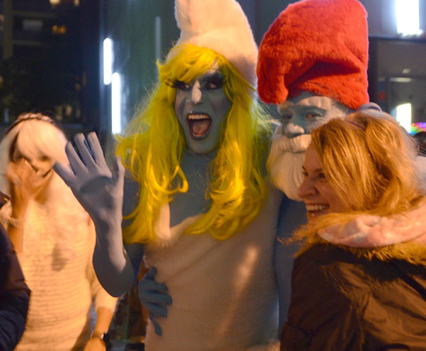 two people dressed as smurfs for Halloween, a large smurfette and a smaller male smurf with a red hat