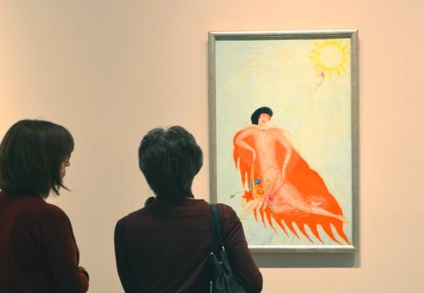 two women looking at a portrait painted by FLorine Stettheimer,