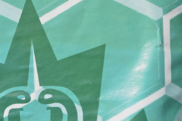 part of a greenish blue poster