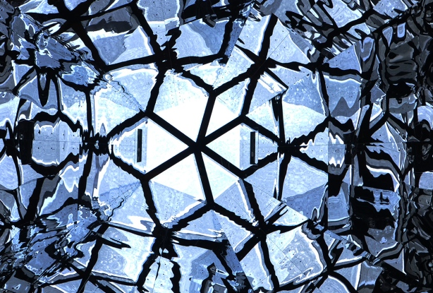 abstract geometrics, triabngles and diamonds, reflective surfaces in a cone shaped skylight, in blacks and blues,