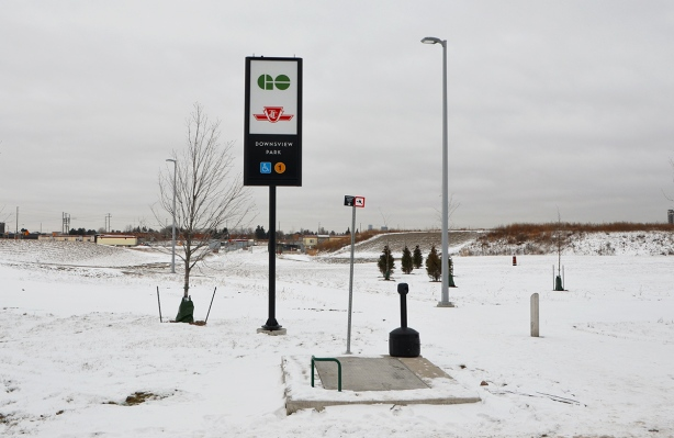 GO Transit and TTC subway sign in the middle of snow covered field
