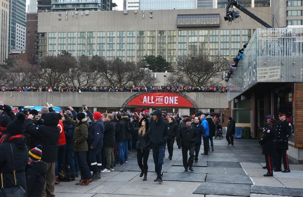 people in Nathan Phillips Square, including all along the south ramp. Banner over the entrancethat says, All For One, which is the tfc motto