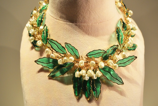 Dior necklace with green glass leaves and white flowers made of beads, gold as well, large and short