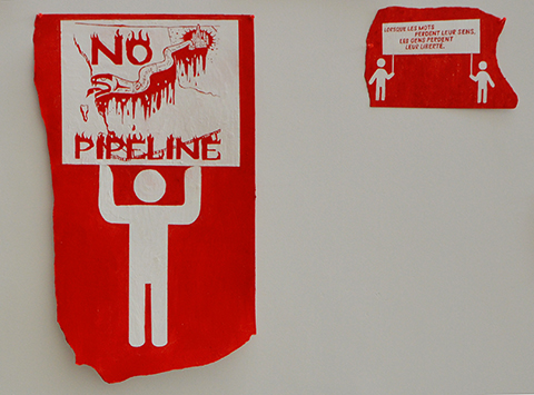 red and white paintings of demonstration signs being held by stick figure men part of an art exhibit at fleck conservatory - sign says no pipeline