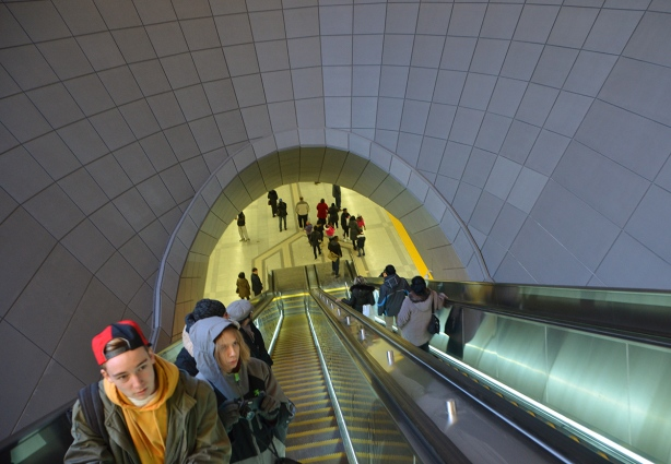 people on a very long escalator at one of the new TTC subway stations in Toronto